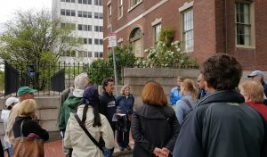 Duane Lucia (center) with tour attendees outside Otis House