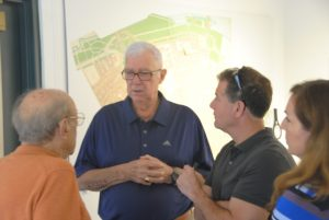 Paul Senecal (center) talks with others at Share Your Story Social - for newsletter